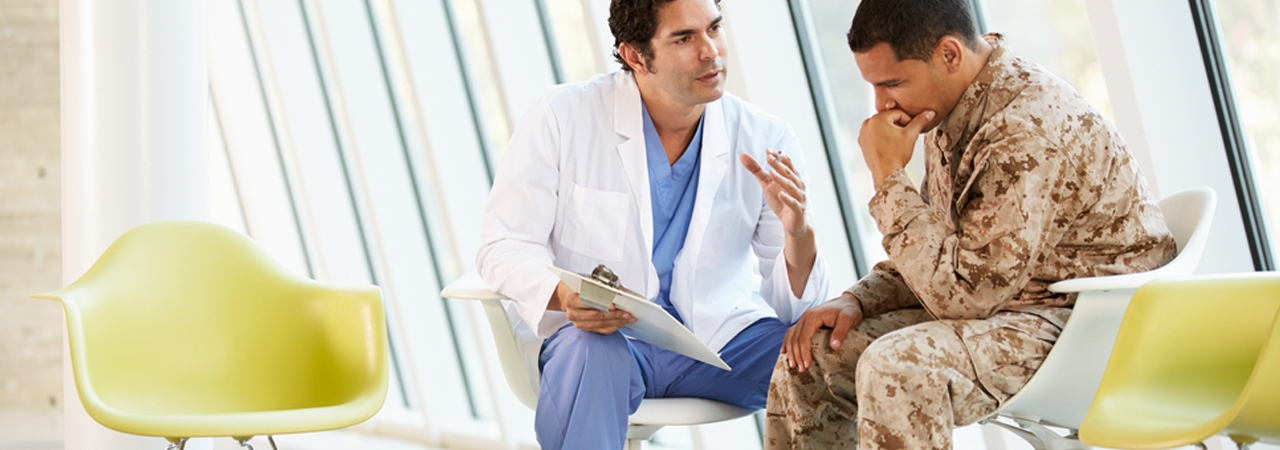 doctor talking to military personnel